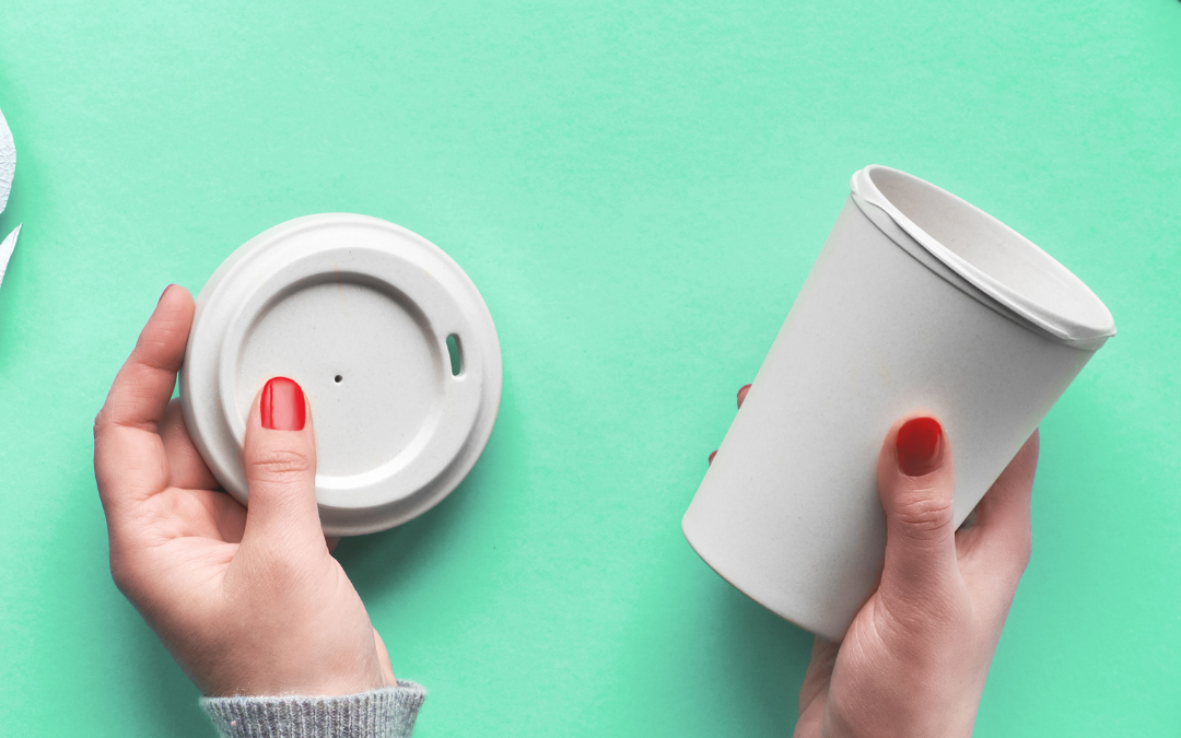 Hands with a reusable coffee cup